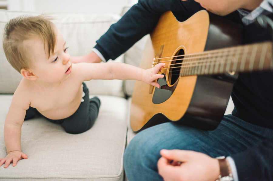 13 dad with baby and guitar at home in dallas