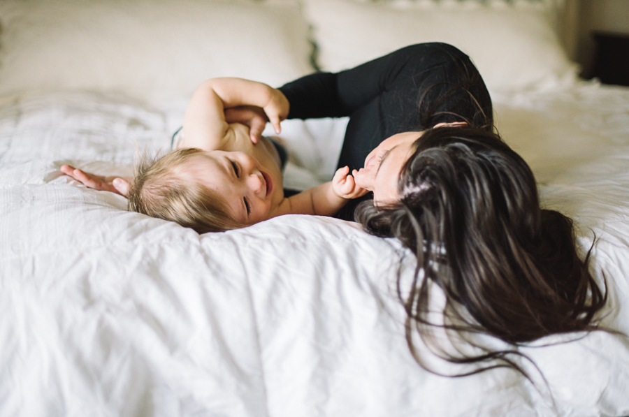 17 mom and baby photographer in dallas white bed